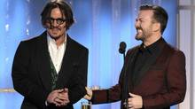 Ricky Gervais (left) tries to bring the funny with actor Johnny Depp at the 69th Golden Globe Awards in Beverly Hills on Jan. 15, 2012. (HANDOUT/Reuters)