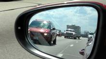 Fast-moving vehicles prepare to overtake Peter Cheney along I-75. (Peter Cheney/The Globe and Mail)