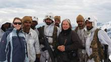 An Afghan police officer shot and killed photojournalist Anja Niedringhaus, third right, and wounded Canadian journalist Kathy Gannon, left. (Uncredited/AP)