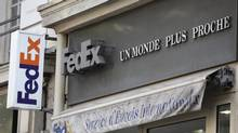 The Fedex delivery company logo at the office of the Haussmann boulevard in Paris, Wednesday July 16, 2014. (Remy de la Mauviniere/AP)