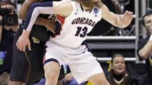 Wichita State's Carl Hall guards Gonzaga's Kelly Olynyk (13) during the first half of a third-round game in the NCAA men's college basketball tournament in Salt Lake City on Saturday, March 23, 2013. (Rick Bowmer/AP)