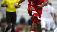 Dwayne de Rosario of Canada shoots the ball during their World Cup 2014 qualifying soccer match against Cuba in Havana June 8, 2012. (ENRIQUE DE LA OSA/REUTERS)