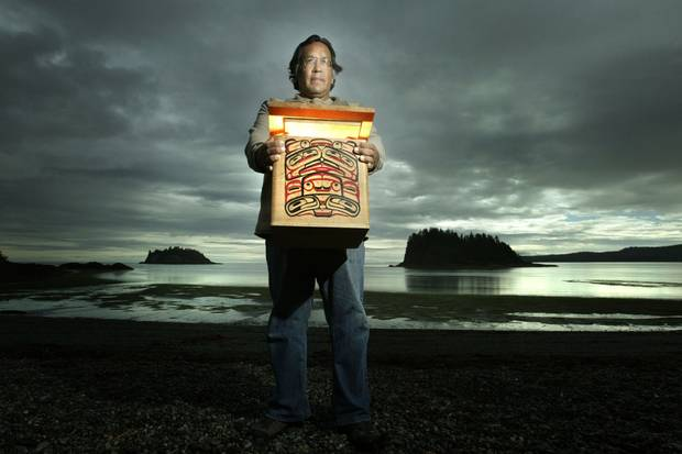 Andy Wilson, shown in Skidegate in 2003, holds one of the 150 traditional bentwood boxes holding Haida remains being repatriated by the Field Museum for burial on Haida Gwaii.