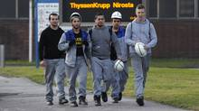 Steel workers of 'ThyssenKrupp Nirosta' arrive for a warning strike in the western city of Krefeld on January 23, 2012. German steel maker ThyssenKrupp and Finland's Outokumpu are in talks over a possible merger of their stainless steel businesses in a long-expected consolidation in a sector struggling with the economic downturn. (INA FASSBENDER/INA FASSBENDER/REUTERS)