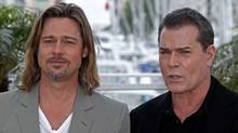 Cast members Brad Pitt, left, and Ray Liotta pose during a photocall for the film Killing Them Softly, in competition at the 65th Cannes Film Festival, May 22, 2012. (Jean-Paul Pelissier/Reuters/Jean-Paul Pelissier/Reuters)