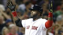 Boston Red Sox's David Ortiz celebrates his two-run home run during the third inning of a baseball game against the Houston Astros in Boston on Aug. 16. (Michael Dwyer/AP)
