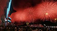 Fireworks explode over the Victoria Harbor in Hong Kong Sunday, July 1, 2012, as part of the celebrations to mark the 15th anniversary of the handover of Hong Kong. (Kin Cheung/Associated Pess)