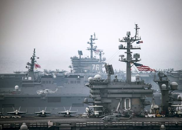 In this handout provided by the U.S. Navy, The Carl Vinson Carrier Strike Group, including the aircraft carrier USS Carl Vinson (CVN 70), operate with the Ronald Reagan Carrier Strike Group including, USS Ronald Reagan (CVN 76), and the Japan Maritime Self-Defense Force ships in the western Pacific region June 1, 2017.
