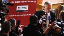 Thomas Minder, Councillor of State and initiator of the 'Against rip-off' initiative speaks to the media during a voting event in Schaffhausen, March 3, 2013. Swiss citizens were on track on Sunday to impose some of the world's strictest controls on executive pay, forcing public companies to give shareholders a binding vote on compensation, initial result projections showed. (MICHAEL BUHOLZER/REUTERS)