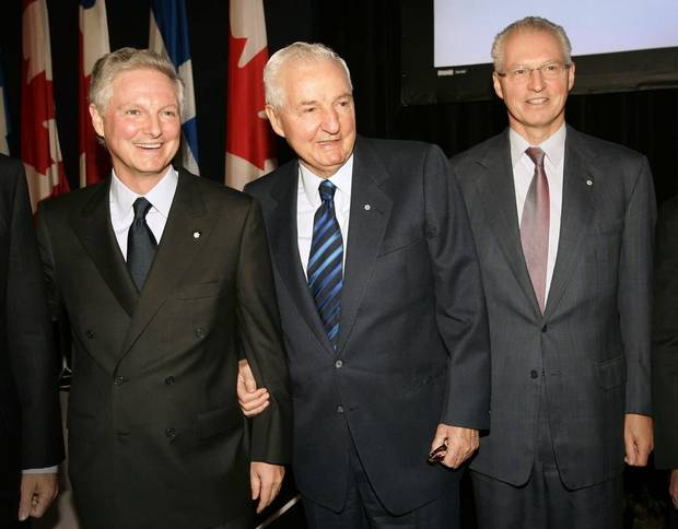 Power Corp. of Canada co-chief executives Paul Desmarais Jr., left, and his brother Andre Desmarais, right, pose with their father Paul Desmarais at the company's annual meeting in Montreal, May 11, 2006.