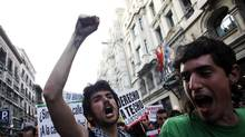 Protesters shout slogans during a demonstration by youth groups in Madrid April 7, 2011 under the slogan 'Youth with No Future' to protest Spain's high youth unemployment rate and government spending cuts. (© Susana Vera/REUTERS)