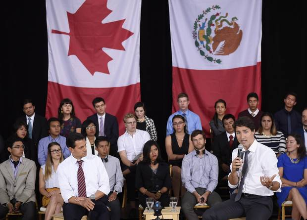 Canada's Prime Minister Justin Trudeau answers a question as Mexico's President Enrique Pena Nieto listens during a Q&A with youth at the Museum of Nature, on Tuesday, June 28, 2016 in Ottawa.
