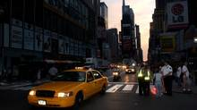 In this Aug. 15, 2003 file photo, a taxi moves down Broadway through the heart of New York's Times Square at dawn. Five years after the nation's worst blackout, executives at some of the nation's largest power generators fear the U.S. could run short on electricity if it does not quickly spend more on infrastructure projects. (CHARLES KRUPA/AP)