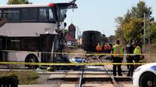 A Via Rail train collided with an Ottawa OC Transpo bus during this morning rush hour September 18, 2013 in Ottawa. (Dave Chan For The Globe and Mail)