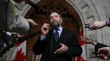 Canada's New Democratic Party leader Thomas Mulcair responds to the budget during a news conference in the House of Commons foyer on Parliament Hill in Ottawa March 21, 2013. (BLAIR GABLE/REUTERS)