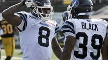Toronto Argonauts corner back Ahmad Carroll celebrates his touchdown during the second half of their CFL game against the Hamilton Tiger-Cats in Hamilton September 3, 2012. (MIKE CASSESE/REUTERS)