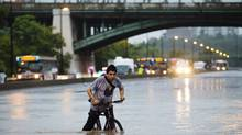 A thunderstorm caused extensive flooding in Toronto July 8, 2013. (Mark Blinch/Reuters)