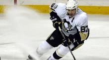 Pittsburgh Penguins center Sidney Crosby stops to stick-handle a loose puck during the first period of an NHL hockey game against the Buffalo Sabres in Buffalo, N.Y., on Wednesday, Nov. 24, 2010. (Don Heupel)