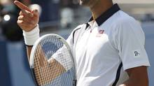 Novak Djokovic of Serbia gestures during a break in play in his men's singles match against Rogerio Dutra Silva of Brazil at the U.S. Open tennis tournament in New York August 31, 2012. (Kevin Lamarque/REUTERS)