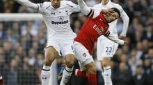 Tottenham Hotspur's Moussa Dembele defends the ball from Arsenal's Mikel Arteta (Kirsty Wigglesworth/AP)