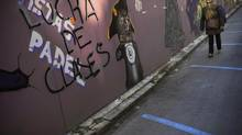 A woman walks past grafitti reading, '' Class Struggle '' in Pamplona northern Spain, on Thursday, Jan. 3, 2013. The number of people registered as unemployed in Spain has gone down, bringing some cheer as the country looks to emerge from recession in 2013. (Alvaro Barrientos/AP)