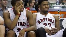 Toronto Raptors forward Rudy Gay (22) and guard Kyle Lowry (3) sit on the bench in the dying seconds of the loss to the Atlanta Hawks in NBA action in Toronto on Wednesday March 27, 2013. (Frank Gunn/THE CANADIAN PRESS)