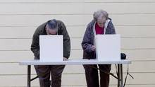 Voters mark their ballot papers in the municipal election in Toronto on Monday. (Chris Young/Canadian Press)