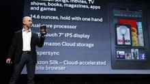 Amazon CEO Jeff Bezos holds up the new Kindle Fire as he speaks at a news conference during the launch of Amazon's new tablets in New York last September. (SHANNON STAPLETON/REUTERS)