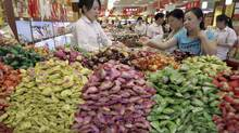 Customers select candy at a food shop in Beijing. (JASON LEE/REUTERS)