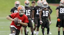 With LeBron James' return, Johnny Football might not be the top star in Cleveland, but Manziel will still get plenty of attention for what he does on and off the field this summer. (Mark Duncan/AP)