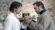"Robert Downey Jr. (left) and Jude Law as Holmes and Watson in a scene from ""Sherlock Holmes: A Game of Shadows"" (Warner Bros.)"