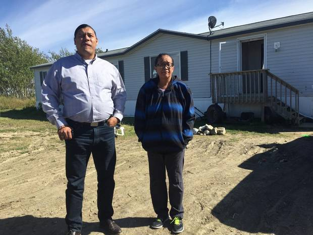 Colten's mother, Debbie Baptiste, stands outside her home on the Red Pheasant First Nation with former chief Sheldon Wuttunee.