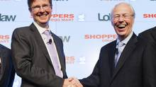 Loblaw executive chairman Galen G. Weston, left, and Shoppers chair of the board Mart Holger Kluge shake hands during a news conference in Toronto, July 15, 2013. (MARK BLINCH/REUTERS)