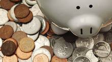 Piggy bank with Canadian coins (iStockphoto/iStockphoto)