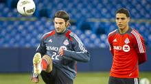 Torsten Frings, left, and Luis Silva of the Toronto FC practise at the Rogers Centre, Tuesday. (Kevin Van Paassen/Kevin Van Paassen/The Globe and Mail)