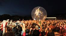 Wayne Michael Coyne, the lead singer and guitarist of American band The Flaming Lips, performs inside a plastic ball during the Optimus Primavera Sound music festival in Porto, Portugal. (Paulo Duarte/AP)