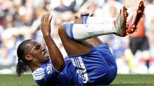 Chelsea's Ivorian striker Didier Drogba on the floor during the English Premier League football match between Chelsea and Norwich City at Stamford Bridge in London, on August 27, 2011. (IAN KINGTON)
