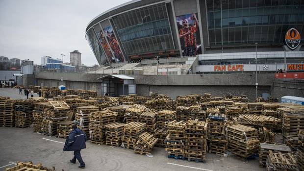 Empty pallets show what the stadium that once housed Donetsk's professional soccer team is now used for: a distribution centre for food aid.