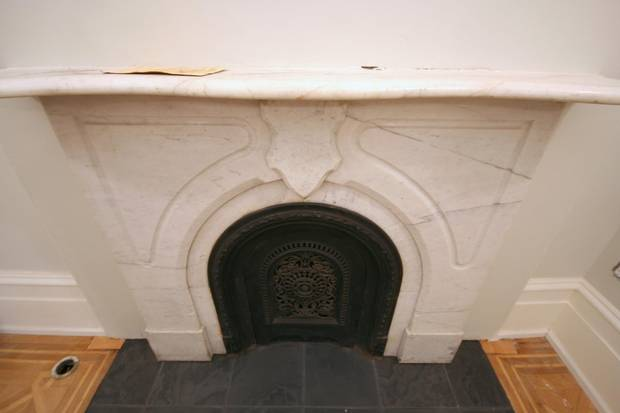 An Owen Sound stone fireplace is located in a double-height lobby of the heritage building.