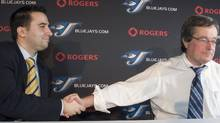Toronto Blue Jays General Manager Alex Anthopoulos (left) shakes hands with President and CEO Paul Beeston.CP/File (FRANK GUNN)