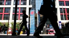 Pedestrians walk past the Canadian Broadcasting Corporation building in Toronto in June of 2006. (GEOFF ROBINS/AFP/Getty Images)
