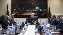 Palestinian prime minister Rami Hamdallah attends his first meeting of the Palestinian unity government cabinet, in the West Bank city of Ramallah on Tuesday. (Majdi Mohammed/Associated Press)