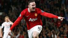 Manchester United's Wayne Rooney celebrates his goal against Fulham during their English Premier League soccer match at Old Trafford in Manchester, northern England, March 26, 2012. (Reuters)
