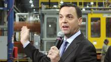 Ontario Progressive Conservative Leader Tim Hudak speaks at a plastics factory in Cobourg, Ont., on Wednesday, May 21, 2014. (Colin Perkel/THE CANADIAN PRESS)