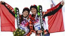 Canadians Kelsey Serwa, left, and Marielle Thompson celebrate after the women's freestyle skiing ski cross finals at the 2014 Sochi Winter Olympic Games in Rosa Khutor, February 21, 2014. (Reuters)