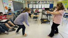 Students act out a skit in their Grade 8 language arts class at St. Joseph School in Calgary, June 13, 2011. (Todd Korol for The Globe and Mail/Todd Korol for The Globe and Mail)