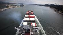 A container ship makes its way toward the Port of Vancouver (JOHN LEHMANN/JOHN LEHMANN/GLOBE AND MAIL)