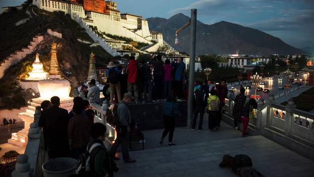 Tourists in front of the iconic Potala Palace in the regional capital Lhasa, in China's Tibet Autonomous Region.