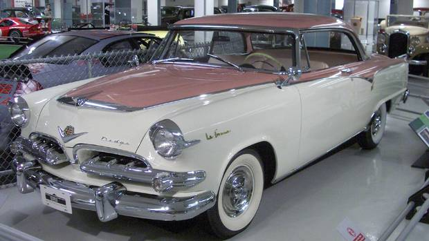 1955 Dodge La Femme had two-tone heather rose and sapphire white paint, pink wheel covers and gold-plated La Femme badges on the front fenders. (Chrysler)