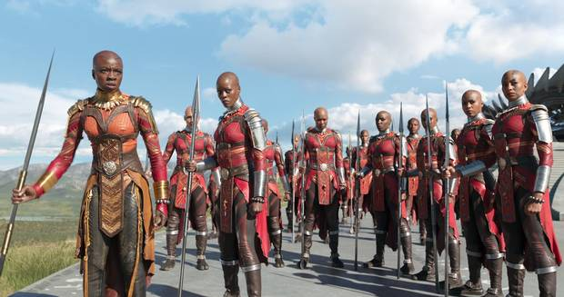 Everything about the film's Dora Milaje warriors, from the bald heads to the lithe frames to the intelligence seems modeled on the Maasai.